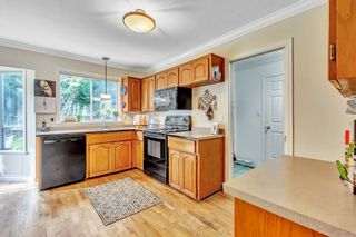 """Photo 12: 1887 AMBLE GREENE Drive in Surrey: Crescent Bch Ocean Pk. House for sale in """"Amble Greene"""" (South Surrey White Rock)  : MLS®# R2542872"""