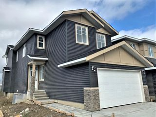 Photo 2: 126 Creekside Way SW in Calgary: C-168 Detached for sale : MLS®# A1144468