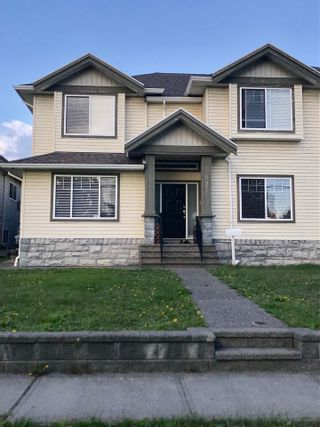 Photo 1: 827 ALDERSON Avenue in Coquitlam: Coquitlam West 1/2 Duplex for sale : MLS®# R2507536