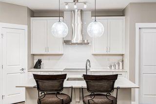 Photo 4: 310 200 Auburn Meadows Common SE in Calgary: Auburn Bay Apartment for sale : MLS®# A1153208