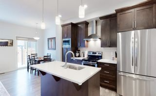 Photo 11: 405 Carringvue Avenue NW in Calgary: Carrington Semi Detached for sale : MLS®# A1087749