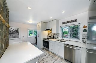 Photo 1: 1644 PITT RIVER Road in Port Coquitlam: Mary Hill House for sale : MLS®# R2586730