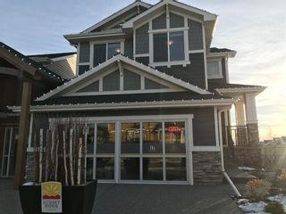 Photo 1: 4 Sunrise Common: Cochrane Detached for sale : MLS®# A1050810