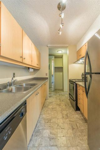 Photo 12: 302 1222 Kensington Close NW in Calgary: Hillhurst Apartment for sale : MLS®# A1056471