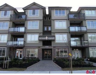 "Photo 1: 404 15368 17A Avenue in Surrey: King George Corridor Condo for sale in ""OCEAN WYNDE"" (South Surrey White Rock)  : MLS®# F2921552"