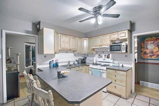 Photo 11: 4 Rossburn Crescent SW in Calgary: Rosscarrock Detached for sale : MLS®# A1073335