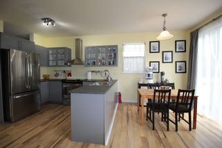 """Photo 7: 18486 65 Avenue in Surrey: Cloverdale BC House for sale in """"Clover Valley Station"""" (Cloverdale)  : MLS®# R2201415"""