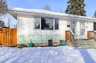 Photo 1: 710 53 Avenue SW in Calgary: Windsor Park Semi Detached for sale : MLS®# A1067398