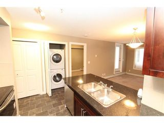 Photo 13: 9104 403 Mackenzie Way SW: Airdrie Apartment for sale : MLS®# A1122241