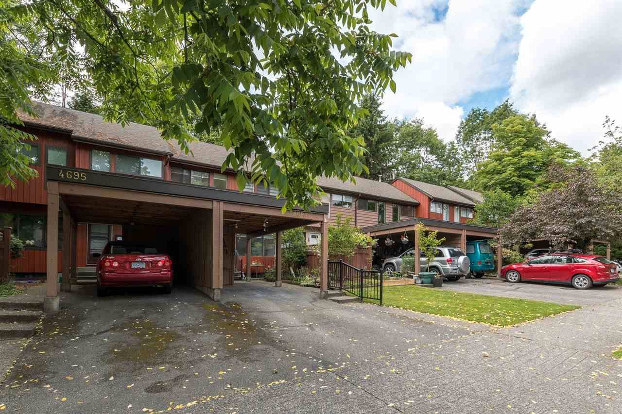 """Main Photo: 4687 GARDEN GROVE Drive in Burnaby: Greentree Village Townhouse for sale in """"Greentree Village"""" (Burnaby South)  : MLS®# R2589721"""