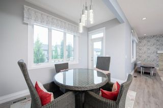 Photo 17: 48 Tremblant Terrace SW in Calgary: Springbank Hill Detached for sale : MLS®# A1131887