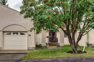 Photo 1: 71 Sandarac Circle NW in Calgary: Sandstone Valley Row/Townhouse for sale : MLS®# A1141051