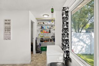 Photo 11: 14 Queen Anne Close SE in Calgary: Queensland Row/Townhouse for sale : MLS®# A1146388