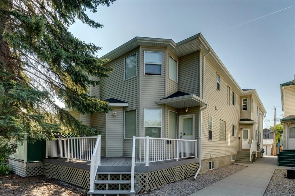 Main Photo: 2107 4 Avenue NW in Calgary: West Hillhurst Row/Townhouse for sale : MLS®# A1129875