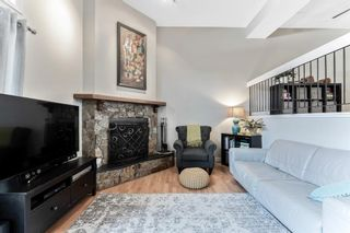 Photo 9: 108 Glamis Terrace SW in Calgary: Glamorgan Row/Townhouse for sale : MLS®# A1070053
