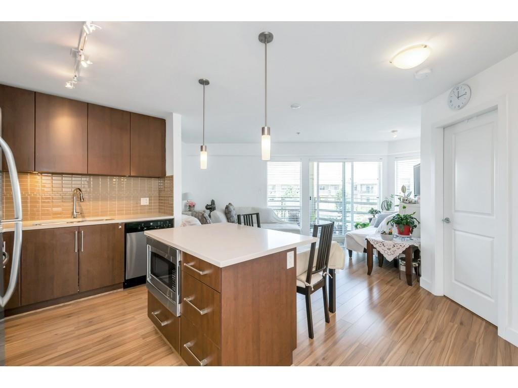 """Main Photo: 450 15850 26 Avenue in Surrey: Grandview Surrey Condo for sale in """"ARC AT MORGAN CROSSING"""" (South Surrey White Rock)  : MLS®# R2605496"""