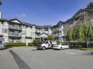 """Photo 1: 311 10743 139 Street in Surrey: Whalley Condo for sale in """"VISTA RIDGE"""" (North Surrey)  : MLS®# R2468543"""