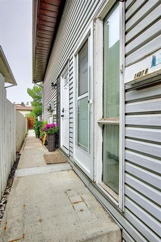 Photo 3: B 1407 44 Street SE in Calgary: Forest Lawn Row/Townhouse for sale : MLS®# A1131513