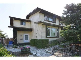 Photo 1: 120 ABOYNE Place NE in CALGARY: Abbeydale Residential Attached for sale (Calgary)  : MLS®# C3629210