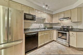 Photo 13: 85 Coachway Gardens SW in Calgary: Coach Hill Row/Townhouse for sale : MLS®# A1110212