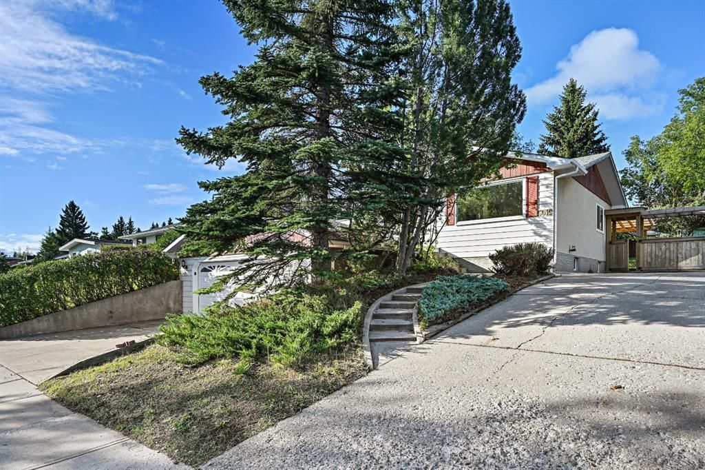 Side Driveway or RV parking. Stairwell to front deck and entrance.