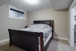 Photo 38: 101 ASPEN SUMMIT Drive SW in Calgary: Aspen Woods Detached for sale : MLS®# A1119132