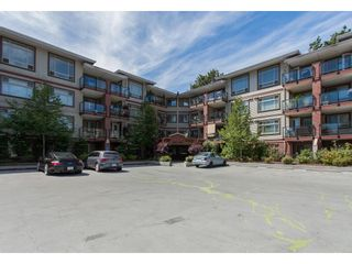 "Photo 1: 118 2233 MCKENZIE Road in Abbotsford: Central Abbotsford Condo for sale in ""THE LATITUDE"" : MLS®# R2387781"
