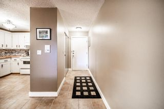 Photo 3: 209 1001 68 Avenue SW in Calgary: Kelvin Grove Apartment for sale : MLS®# A1147862