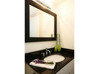 Photo 7: # 108 13507 96TH AV in Surrey: Whalley Condo for sale (North Surrey)  : MLS®# F1417466
