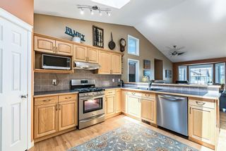 Photo 10: 538 Country Meadows Way NW: Turner Valley Detached for sale : MLS®# A1118129