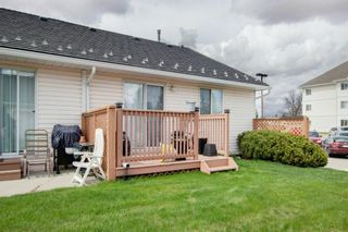 Photo 26: 9 209 Woodside Drive NW: Airdrie Row/Townhouse for sale : MLS®# A1106709