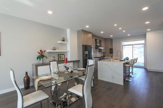 Photo 4: 2410 54 Avenue SW in Calgary: North Glenmore Park Semi Detached for sale : MLS®# A1082680