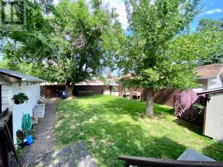 Photo 38: 415 3A Street W in Brooks: House for sale : MLS®# A1129371
