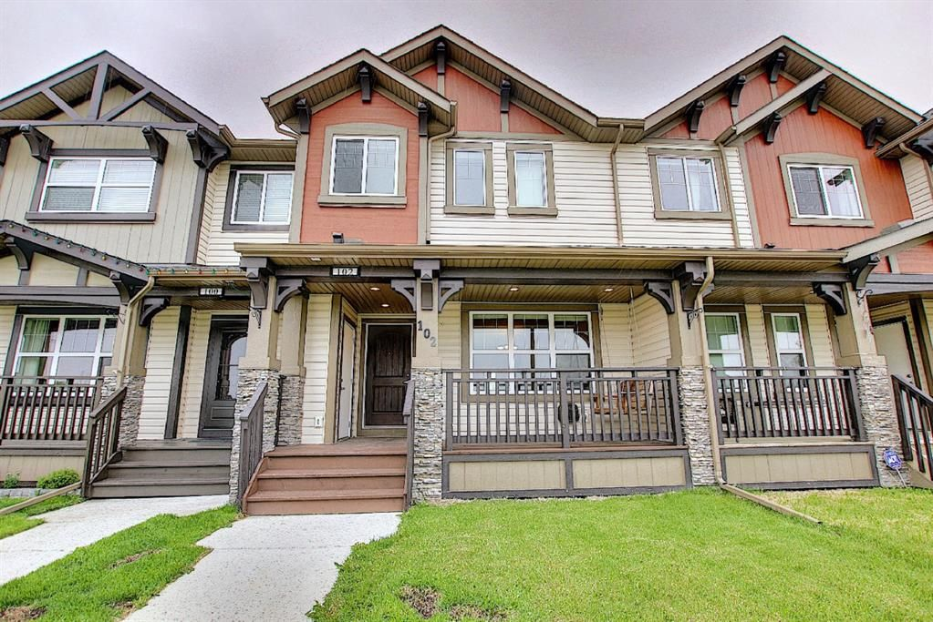Main Photo: 102 Clydesdale Way: Cochrane Row/Townhouse for sale : MLS®# A1117864