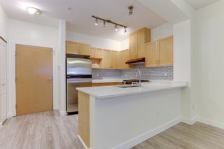 """Photo 11: 108 2951 SILVER SPRINGS Boulevard in Coquitlam: Westwood Plateau Condo for sale in """"TANTULUS"""" : MLS®# R2601029"""