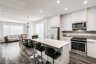 Photo 9: 125 Redstone Crescent NE in Calgary: Redstone Row/Townhouse for sale : MLS®# A1124721