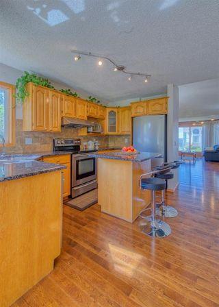 Photo 10: 404 HAWKSIDE Mews NW in Calgary: Hawkwood Detached for sale : MLS®# A1014613