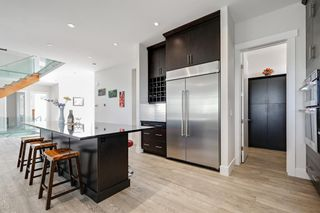 Photo 11: 40 Elveden Bay SW in Calgary: Springbank Hill Detached for sale : MLS®# A1129448