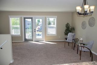 Photo 4: 1 23 Cougar Cove N in Lethbridge: Uplands Residential for sale : MLS®# LD0188989
