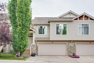 Photo 2: 26 7401 Springbank Boulevard SW in Calgary: Springbank Hill Semi Detached for sale : MLS®# A1139691
