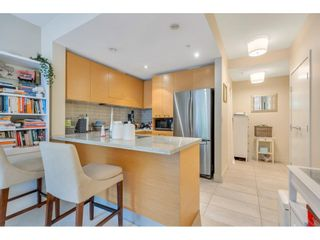 """Photo 5: 102 6015 IONA Drive in Vancouver: University VW Condo for sale in """"Chancellor House"""" (Vancouver West)  : MLS®# R2618158"""