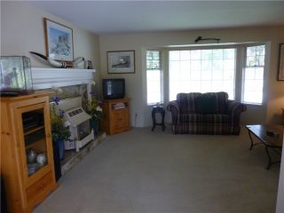 Photo 3: 1424 FOSTER Avenue in Coquitlam: Central Coquitlam House for sale : MLS®# V1008623