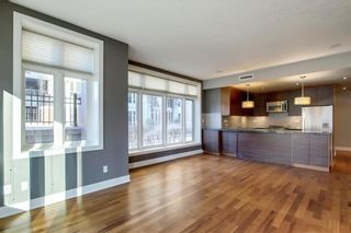 Photo 2: 104 660 EAU CLAIRE Avenue SW in Calgary: Eau Claire Row/Townhouse for sale : MLS®# C4290088