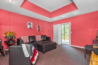 "Photo 21: 36 23281 KANAKA Way in Maple Ridge: Albion Townhouse for sale in ""WOODRIDGE"" : MLS®# R2576550"