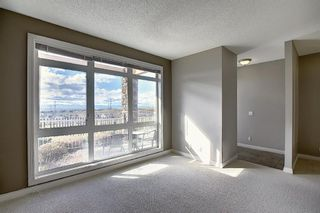 Photo 6: 4 145 Rockyledge View NW in Calgary: Rocky Ridge Apartment for sale : MLS®# A1041175