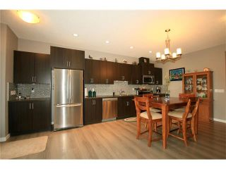 Photo 7: 510 RIVER HEIGHTS Crescent: Cochrane House for sale : MLS®# C4074491
