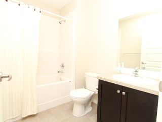 Photo 9: 4105 1001 EIGHTH Street NW: Airdrie Townhouse for sale : MLS®# C3639414