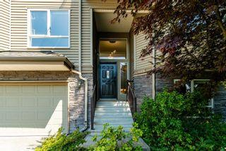 "Photo 1: 401 1215 LANSDOWNE Drive in Coquitlam: Upper Eagle Ridge Townhouse for sale in ""SUNRIDGE ESTATES"" : MLS®# R2603990"