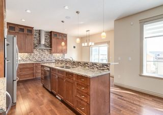 Photo 8: 66 ASPENSHIRE Place SW in Calgary: Aspen Woods Detached for sale : MLS®# A1106205