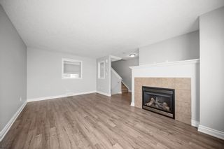 Photo 5: 5 Cougar Ridge Mews SW in Calgary: Cougar Ridge Row/Townhouse for sale : MLS®# A1105171